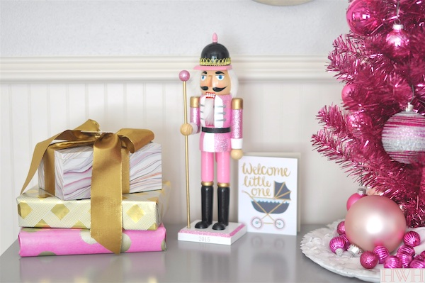 Festive holiday nursery with pink tinsel christmas tree and pink nutcracker | Honey We're Home