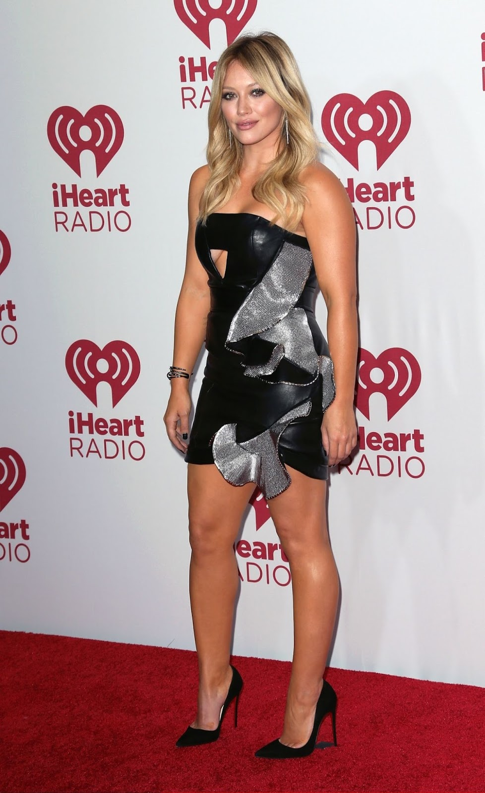 Hilary Duff wears a leather mini dress to the 2014 iHeart Radio Music Festival