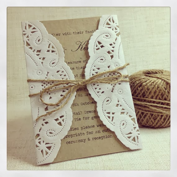 This set of 50 wedding invitations by StunningStationary on Etsy feature a vintage doily wrapping up the wedding invitation, tied up in a jute bow.