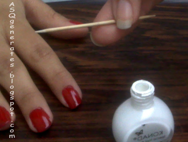 Grab white nail polish and toothpick