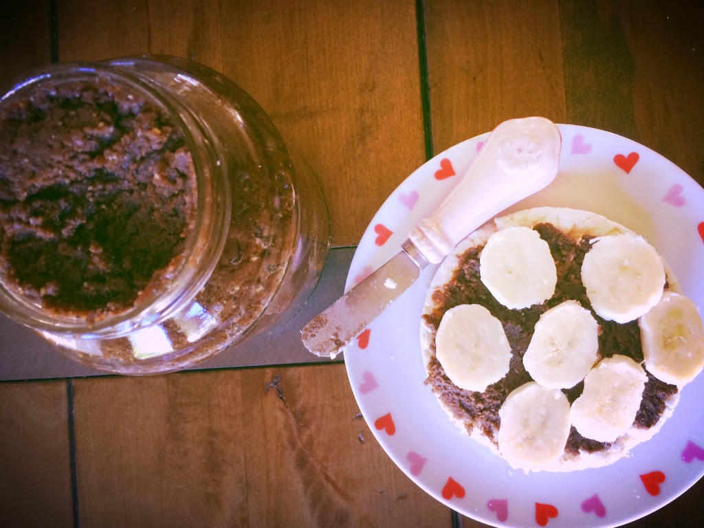 Espresso Seed Butter on rice cake with banana: Clean Eating Treat