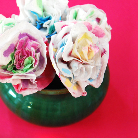 Turning toilet paper squares into paper roses