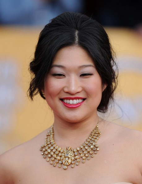 Jenna Ushkowitz in a gold silk strapless organza gown by Badgley Mischka with a sweetheart neckline and paired with Ushkowitz's gold and diamond necklace at the 17th Annual Screen Actors Guild Awards held at The Shrine Auditorium on January 30, 2011 in Los Angeles, California.