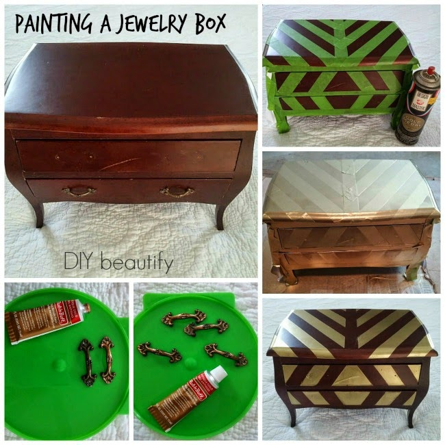 spray painting gold stripes on a jewelry chest