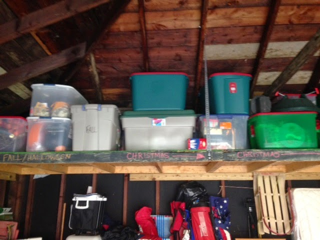 Organized holiday decorations in garage