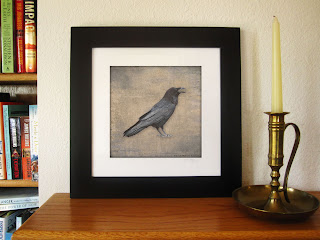 Framed raven print, a solitary raven with each feather in exquisite detail is printed on a background texture with the look of old linen.