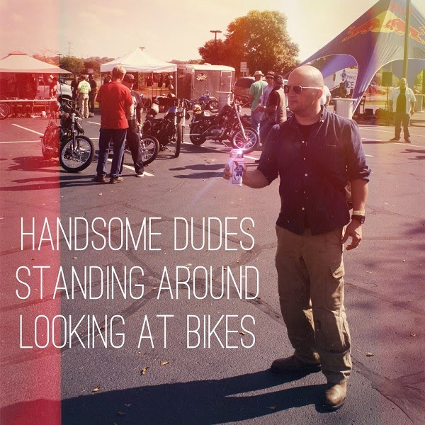 Handsome Dudes Standing Around Looking At Bikes