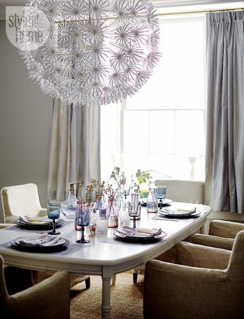 huge modern chandelier in dining room
