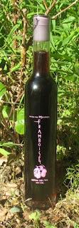 A bottle of Inspire Moore's raspberry framboise