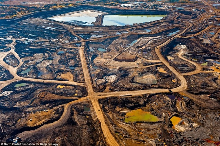 The scars left behind from the mining of oil sands in the Canadian province of Alberta.