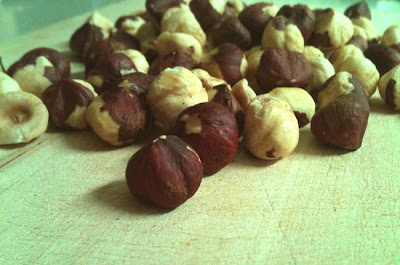 Whole Roasted Hazelnuts on Cutting Board