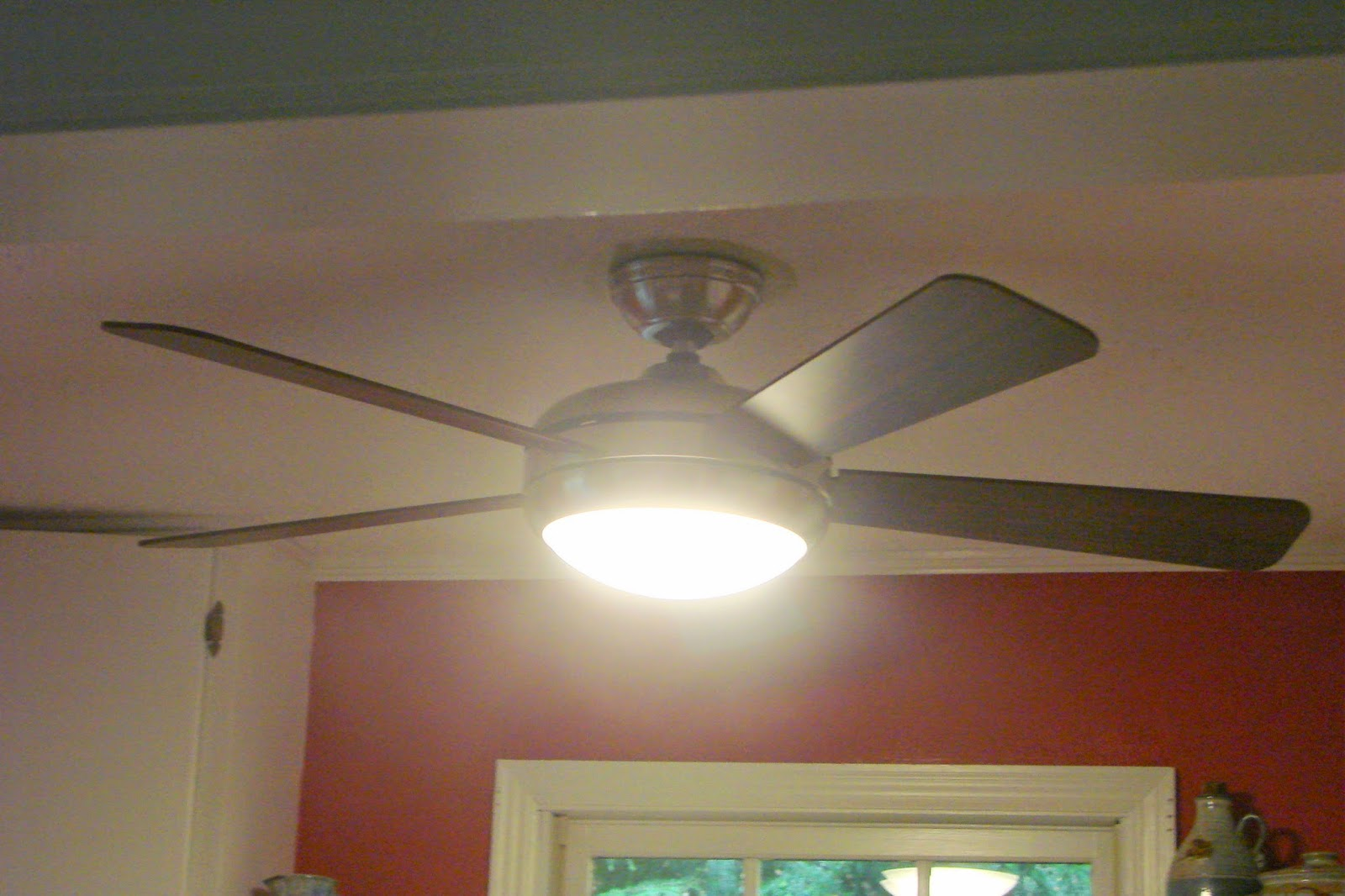 i wasnt fan kitchen fan light The kitchen to this more modern fan with an LED light fixture It looks a little like a space ship to me and operates by remote