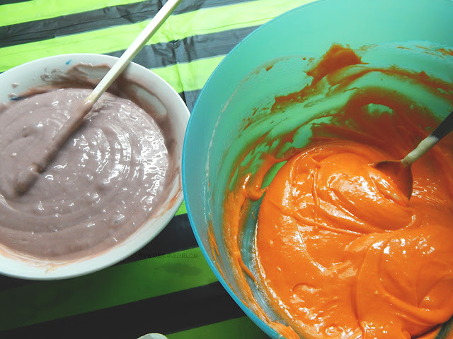 Purple vanilla cake batter and orange vanilla cake batter