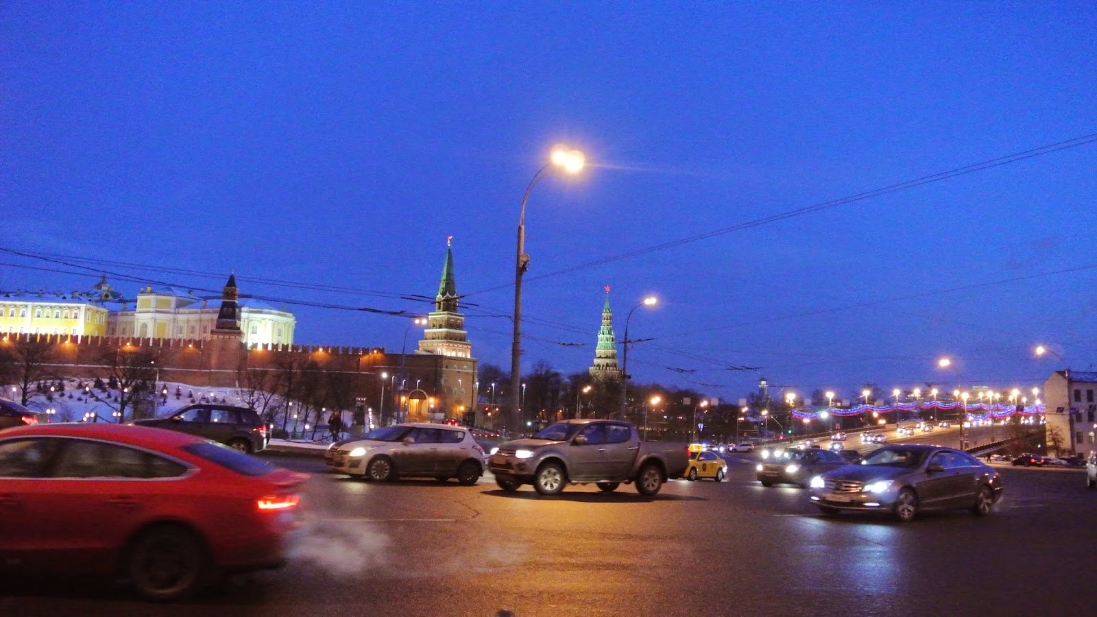 Busy traffic junction outside the Kremlin at night, Moscow