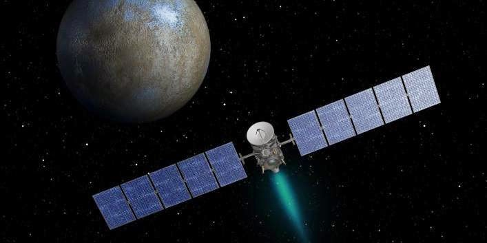 This artist's concept shows NASA's Dawn spacecraft heading toward the dwarf planet Ceres. Image Credit: NASA/JPL-Caltech