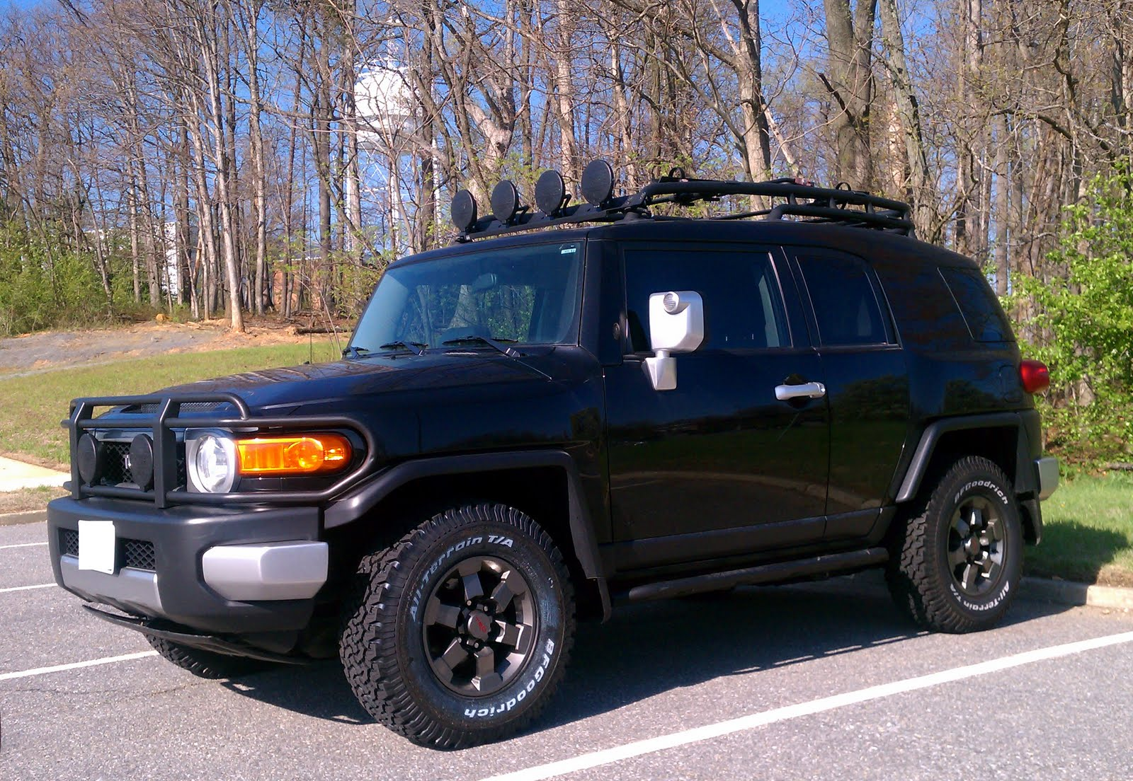 ... the other street tires that were on the FJ when I purchased it. I left  one as a spare and bought a cover for it. The other three are now in  storage.