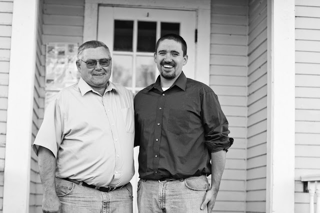 son and his father at an old schoolhouse