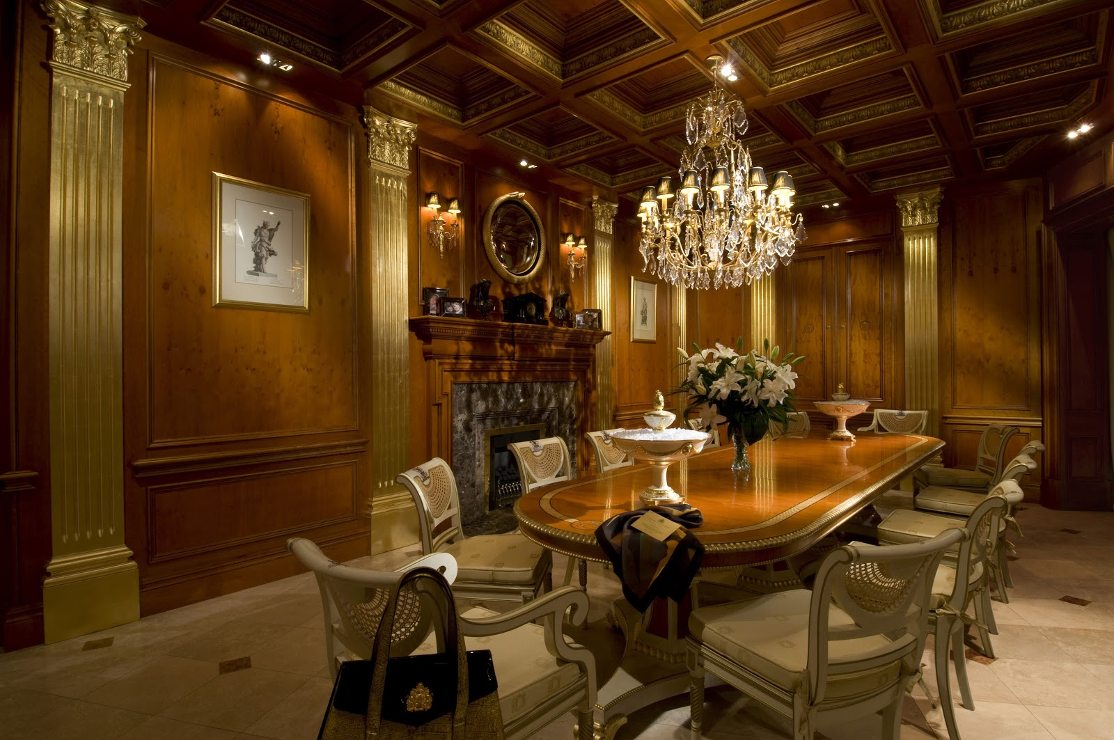 crystal dining room for luxurious impression. Architectural Paneled Dining Room In Yew With Gold-leafed Columns And Featuring The Clive Christian Fireplace. Empire Table Gold Crystal For Luxurious Impression