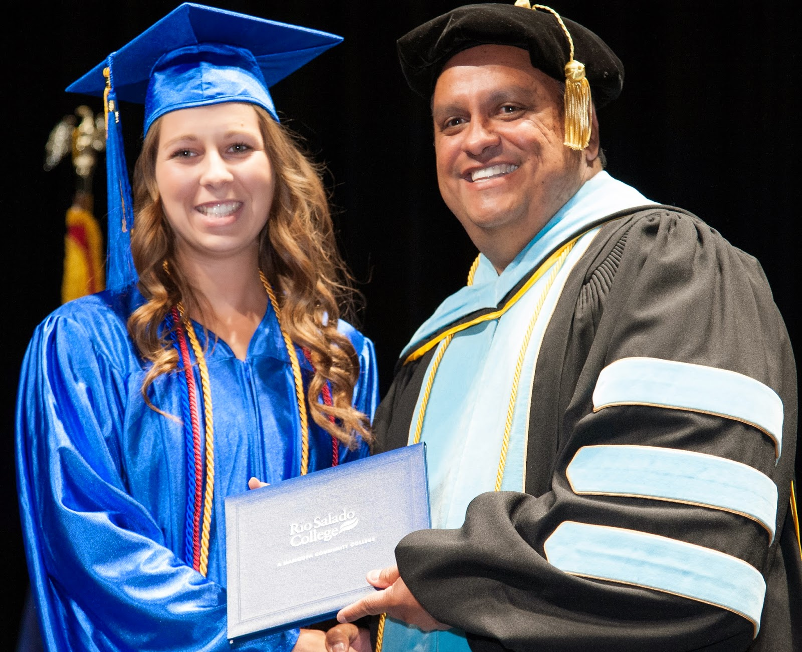 Image of 2014 graduate with President Chris Bustamante