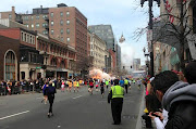 About four hours into the Boston Marathon an explosion near the finish line . (better)