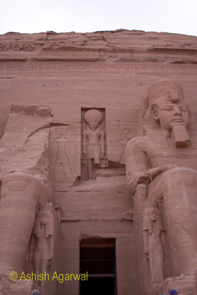 View of the entrance to the structure of the Abu Simbel temple along with  statues on either side