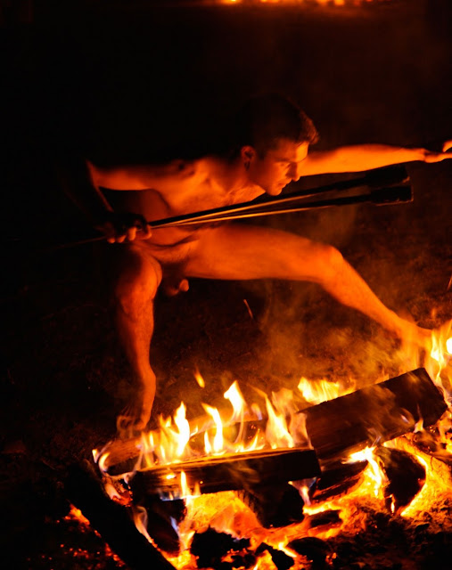 nude men around camp fire