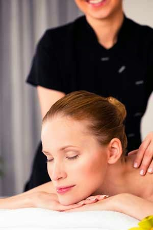 New mother receiving a Post Natal Massage for stress relief and pain