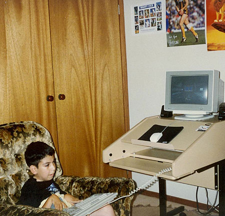 Image of Izzy playing Doom on his cousin's PC in 1994-ish using pure keyboard controls.