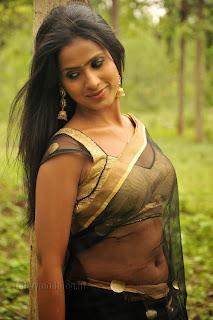 Prashanthi cute new actress in Transparent Saree and Golden Choli Stunning Pics