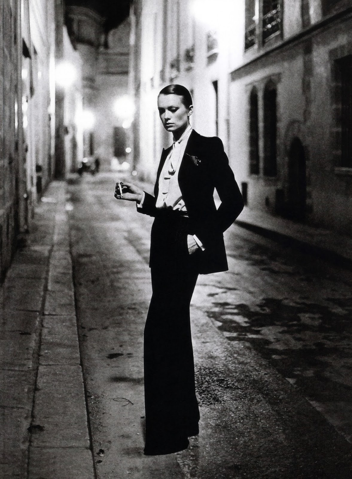 Vibeke wearing a grey stripped suit (le smoking) photographed by Helmut Newton for Vogue Paris 1975