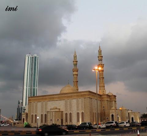 Dark Clouds, Mosque, Sky Scraper and Cars... Beauty...