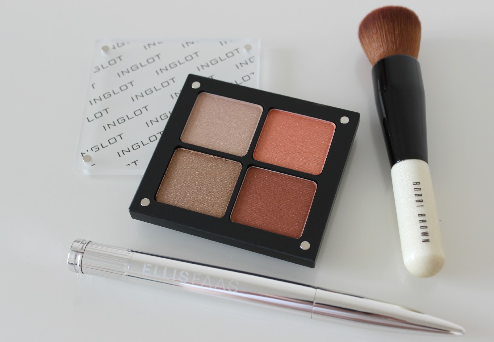 A picture of Inglot 4 Pan Eyeshadow Palette, Bobbi Brown Full Coverage Face Brush and Ellis Faas Hot Lips L404