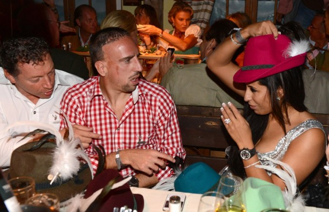 franck ribery and wahiba belmahi funny hats exchange at the oktoberfest its a wag wag world. Black Bedroom Furniture Sets. Home Design Ideas