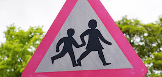 School children crossing warning road sign