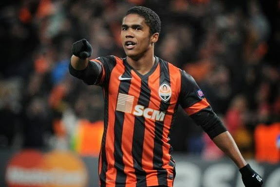 Shakhtar Donetsk player Douglas Costa celebrates after scoring against Real Sociedad