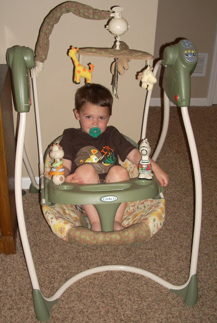 toddler in a graco baby swing