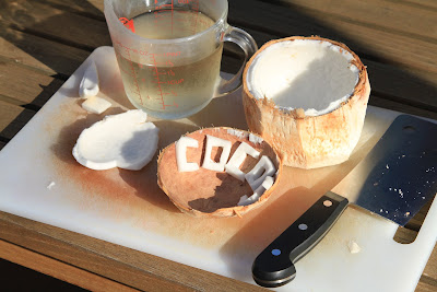 Cutting Board with Coconut Open and Coconut Water