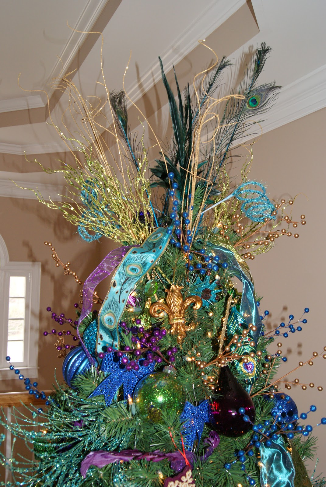 the peacock topper inspiration was the feather we found and then aqua spirals we also have green tall picks 5 peacock feathers and 24 gold spirals - Peacock Christmas Tree Topper