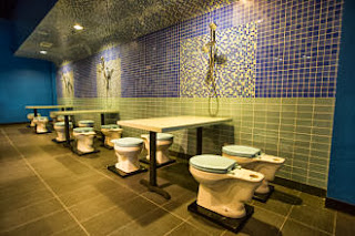 Magic-Restroom-Cafe-dining-area-guests-sit-on-toilets
