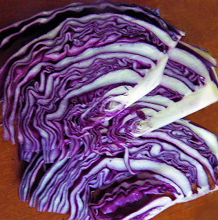 Slices of Purple Cabbage on Yellow Cutting Board