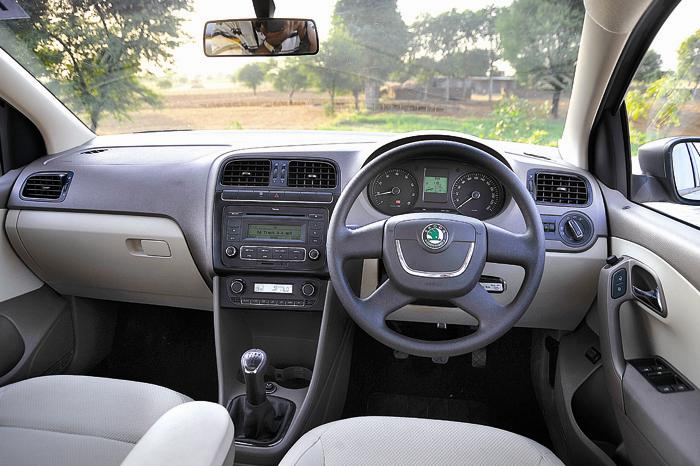 Test drive and review of new skoda rapid car to ride for Skoda rapid interior and exterior photos