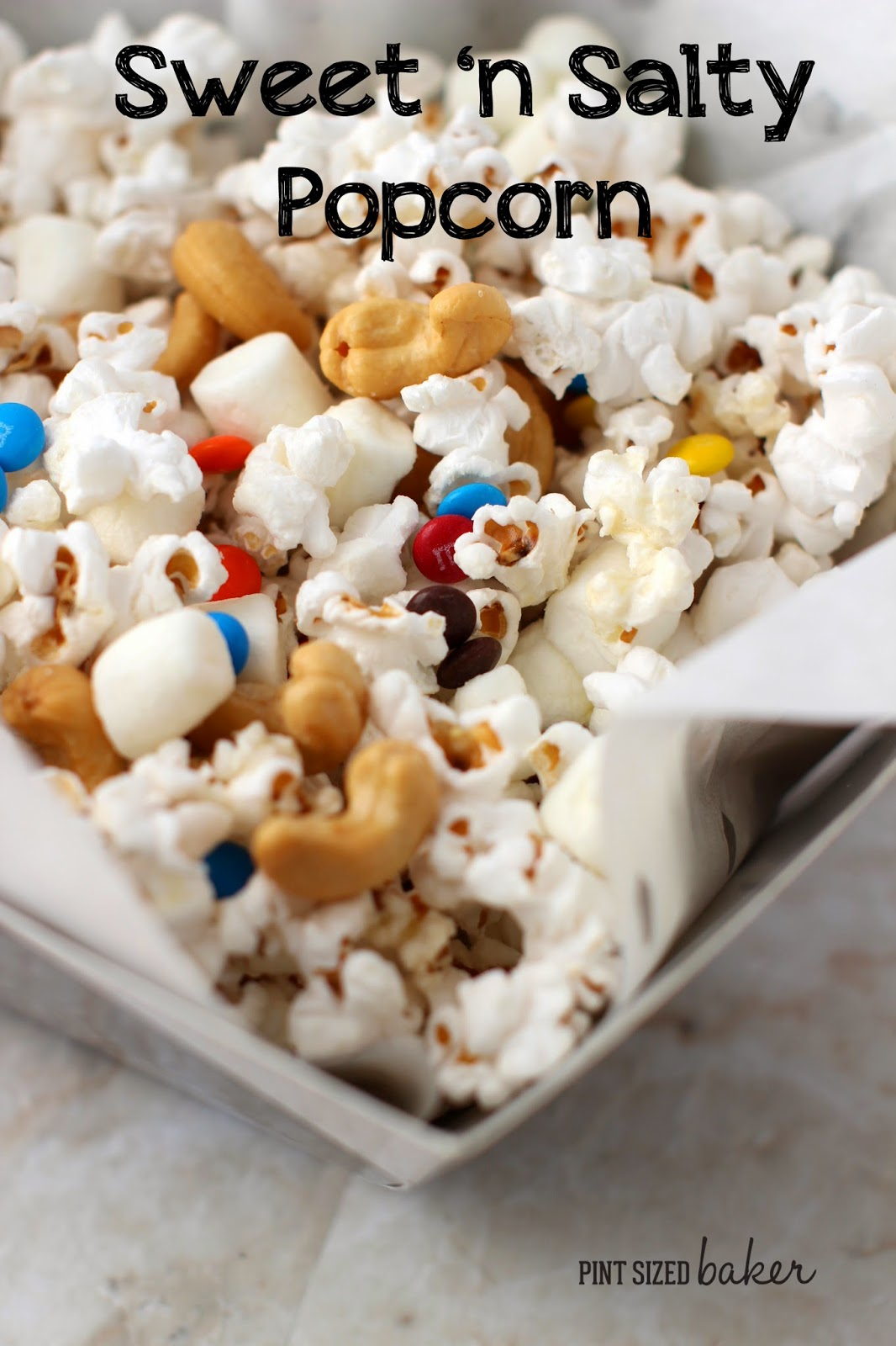 Sweet and Salty is the perfect combination! Salty Cashews with sweet mini marshmallows and M&M's. Perfect for snacking on during the game!