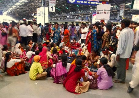 crowd of women at a railway station in India