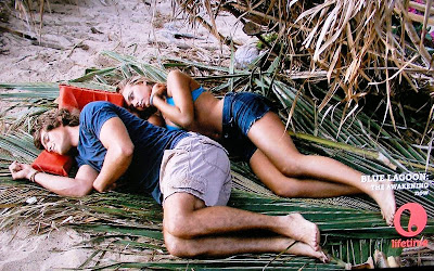 High school Aussie actors Brenton Thwaites (Dean) spooning with Indiana Evans (Emma) in 2012 Lifetime movie version of original 190 film with Christopher Atkins and Brooke Shields