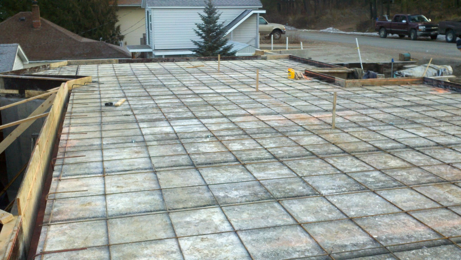 Tanner lake place the garage floor slab is poured in for Garage slabs