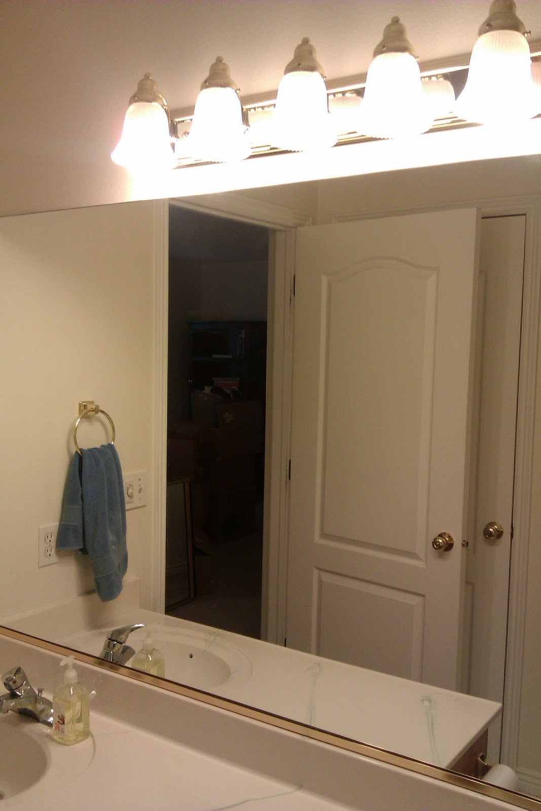 Happy Habits: Tutorial: Adding Molding to a Builder Grade Mirror