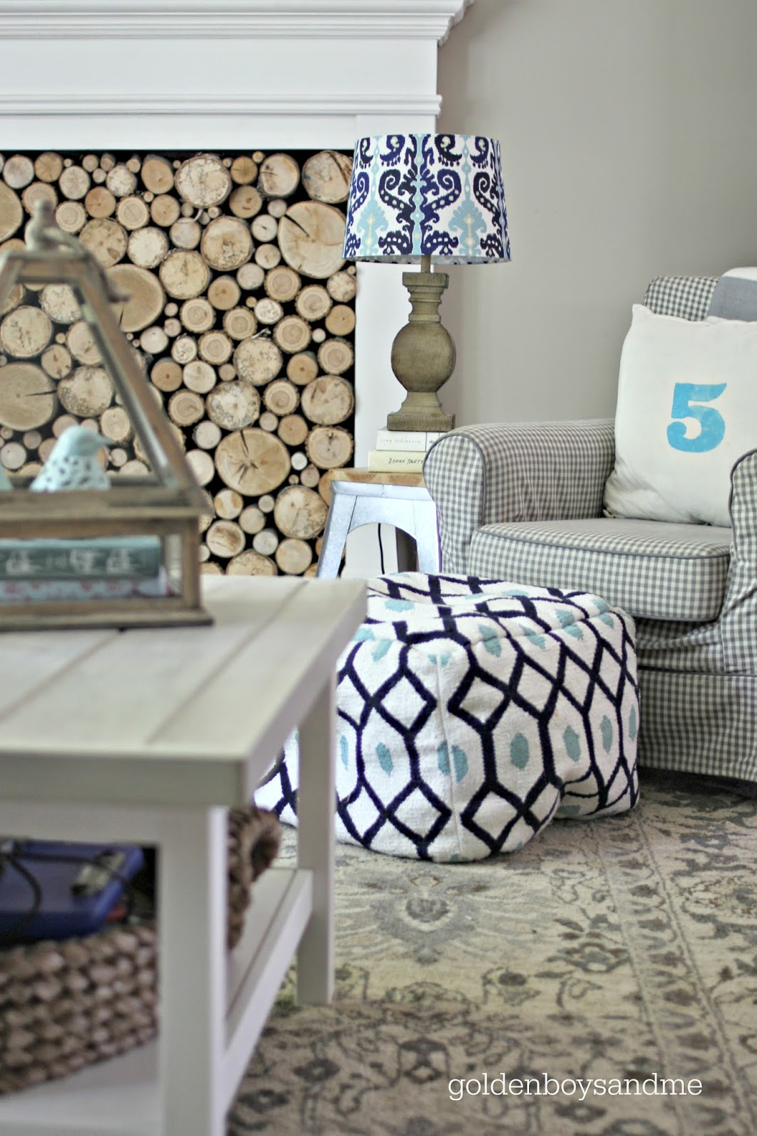 Target pouf, Ikea Jennylund chair, stenciled pillow, galvanized stool used as a side table