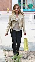 Hilary Duff holding a bag