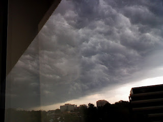 storm clouds forming outside office window