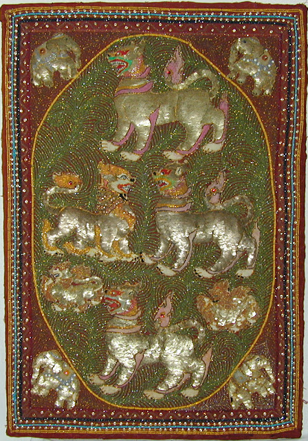 Traditional wall hanging of Myanmar depicting mythical Chinthes (lions)